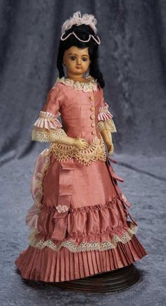 French Bisque Poupee by Emile Jumeau with Rare Mulatto Complexion ~~Marks: (artist checkmarked). Comments: Emile Jumeau, circa 1878. Value Points: rare complexion with fine flawless complexion, sturdy original body.
