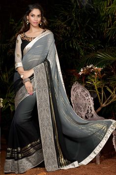 Black and grey georgette saree with black and grey georgette blouse.  Embellished with resham, zari, stone and hand.  Saree comes with u neck blouse.  It is perfect for festival wear, party wear and wedding wear.  Andaaz Fashion is the most popular designer wear online ethnic shop brands.  http://www.andaazfashion.us/womens/sarees/occasion/bridal-wear-saree
