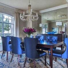 Lovely blue chairs adorn a dining room table - An Interior Design Tribute to Blue