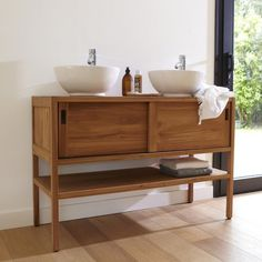 Very practical, it is equipped with two sliding doors opening onto two niches and lower, allowing you store all of your textiles and bath accessories!<br/>Let's try the simple lines, combined with the quality of solid teak wood ...The cabinet Arty duo for a bathroom natural! Each of the manufacturer's creation comes from craft production, and thus stands for authenticity. Any imperfections add to the charm of the product and are an expression of the individual hand ...