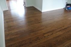 Floor stain of mix, Minwax Dark Walnut and Provincial stains (link to good info on staining hardwoods) Wood Floor Stain Colors, Types Of Wood Flooring, Oak Laminate Flooring, Refinishing Hardwood Floors, Kitchen Flooring, Flooring Ideas, Floor Refinishing, Farmhouse Flooring, Kitchen Cabinets