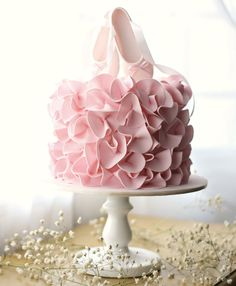 Ballerina birthday cake with pink ruffles and ballet shoe cake topper