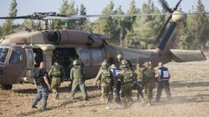 Three IDF soldiers killed in booby-trapped @UNRWA clinic - An injured Israeli soldier is evacuated by helicopter from near the Israeli border with Gaza Strip on July 28, 2014, (photo credit: Yonatan ...