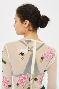 Dress up your base layer with this embroidered body in cream, featuring all-over bird embroidery. In a semi-sheer style, it comes with long sleeves – the perfect transitional party piece.