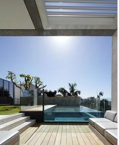 Infinity edged glass pool. Tobias Partners architects, Australia.