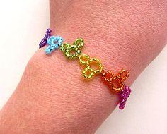 World of Color Disneyland Disney's California Adventure Inspired Beaded Hidden Mickey Mouse Bracelet Rainbow. $20.00, via Etsy.