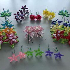 Cabeza de #tembleques sencilla con perlas tornasol para decoración en pistilos. #temblequespanameños #artesanía #Panamá #típico #folklore #pollera #cabezadetembleques #temblequesdecolores