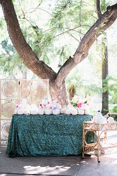 Add a pop to the drink station or escort card table with a sparkling fabric! Perhaps even use the same fabric as a table-runner, or on the backs of chairs to tie it all together! Wedding Party Favors, Diy Wedding Decorations, Tropical Wedding Decor, Coconut Bars, Coconut Drinks, Event Planning Design, Elegant Flowers, Wedding Chairs, Green Wedding Shoes