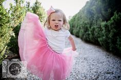 Little girl playing with her pink tutu at this family session at Baxter Gardens in Fountain City by Knoxville Wedding Photographer, Amanda May Photos