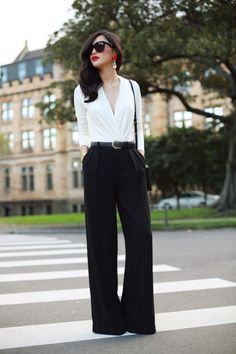 Classic Black and white outfit.  Love how  the plunging neckline is defined but very modest. Also loving the red accents!