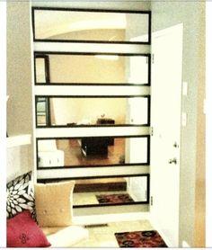 Great idea hanging vertical mirrors horizontally x 5!