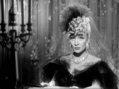 """Marlene Dietrich in """"The Flame of New Orleans"""" 1941 wearing Joseff Hollywood Jewelry"""