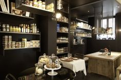 Beautiful product display.  Like the dark paint with the shiny bottles and clear domes.
