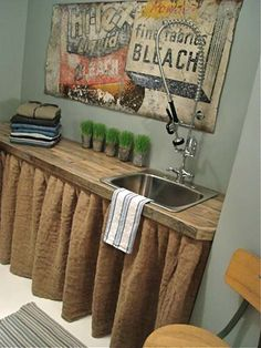 Love the skirt and the art above the sink. Love it. Google Image Result for http://www.atticmag.com/wp-content/uploads/2012/07/dec-laun-charming2-435.jpg
