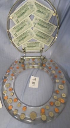 Unique Toilet Seat With Dollar Bills And Coins - Sold for $35 from a MaxSold Online Auction