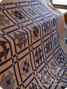 Amy's Scrappy Blue Churndashes. Ruby Blue Quilting Studio