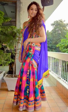 Lehenga Saree yet again but in a printed soft material. Accessorize it with a emerald stone brooch.