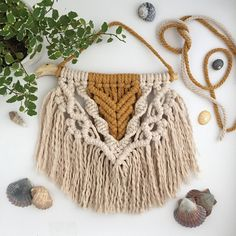 ➸ Handmade macramé wall art made with 5mm natural and mustard Australian cotton on a piece of locally sourced driftwood. ➸ The piece in the image measures 26cm wide x 32cm long (including wood and hanging cotton). ➸ A cute addition to your photo collage wall. ➸ Made in a pet and