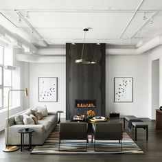 """We had this fireplace clad in hot rolled steel, flanked by Smokey Birds from @art_squared #toronto #fireplace #white #croma #loft #modern #art photography…"""