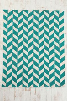 Urban Outfitters always has cool and reasonably priced rugs in fun patterns.  Herringbone Rug