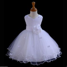 White Flower Girl butterfy tulle dress 20 colors by ekidsbridalusa The skirt has 4 layers, top and layers is made of elegant tulle with a rattail edge. The elegant upper bodice feature is made out of Satin Poly. Wedding Flower Girl Dresses, Tulle Wedding, Little Girl Dresses, Girls Dresses, Dress Wedding, Flower Girls, Robes Tutu, Kids Frocks, Baptism Dress