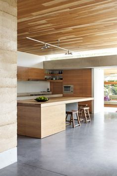 rammed earth, polished concrete, locally sourced wood