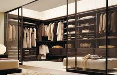 Closet. Beautiful. Love the glass to give the master bedroom the feel of more space, but my closet would have to be perfectly organized and I have a few colored clothes that would ruin the color scheme.
