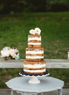 Rustic blueberry naked wedding cake