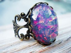 smooth oval fire opal cabochon on filigree antiqued brass lace floral ring
