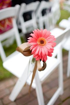 would love to have white wooden chairs like this at the reception, maybe flowers like this at the bridal party's chairs!