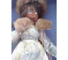 COLLECTIBLE DOLL DRESSED IN BEADED SATIN, $44.99