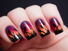 cattails at sunset: cattail silhouettes painted over purple/red/orange gradient manicure