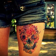 Floral skull thigh tattoo. Not into the skull thing but this ones pretty sweet. Girls and badass at the same damn time.