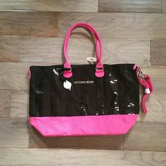 Victoria's Secret Weekender Tote Bag NWT Large sized cotton tote with black sequins. Bottom of bag expands out for a flat bottom to accommodate more items inside. Even comes with an adjustable shoulder strap that hooks onto both sides (see first photo). Would make a great overnight or beach bag ?? Victoria's Secret Bags Travel Bags