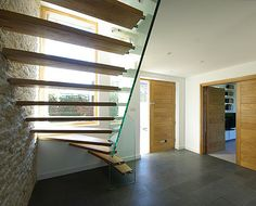 glass and timber staircase contemporary oak doors and slate grey floor tiles against pure white || Windrush