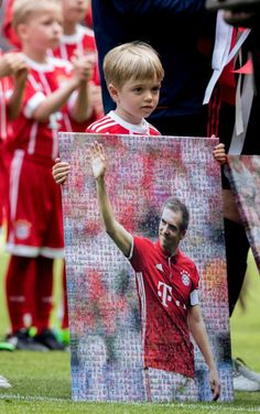 Julian Lahm, the son of Philipp Lahm of FC Bayern Muenchen holds the picture of his father during Phillip Lahm's farewell ceremony ahead of the Bundesliga match between Bayern Muenchen and SC. Get premium, high resolution news photos at Getty Images Soccer Players, Football Soccer, Philipp Lahm, Sc Freiburg, World Cup Games, Boy Girl Names, Thomas Muller, Fc Bayern Munich, Unique Baby Gifts