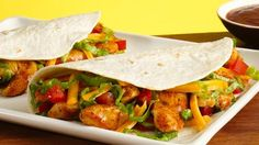 A taco dinner kit makes it easy to get Mexican on the table in less than half an hour !Ingredients  1 tablespoon oil 2 (9-oz.) pkg. frozen cooked chicken breast strips 1 (14.5-oz.) pkg. Old El Paso® Soft Taco Dinner Kit 2/3 cup water Shredded lettuce Shredded cheese Chopped tomatoes