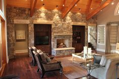 old world style living room with stone fireplace