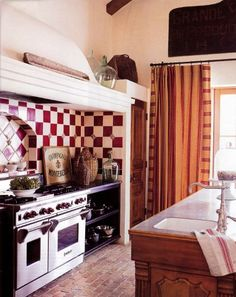always dreamed of having a red-gingham kitchen...love the old signs