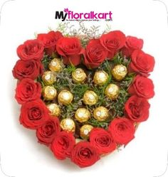 Heartshape Chocolate Bouquet Heart shape Arrangement of 17 red roses and lots of green fillers with 16 pieces of Ferrero Rocher chocolates. Chocolate Flowers, Chocolate Bouquet, Chocolate Baskets, Valentine Heart, Valentine Day Gifts, Valentines, Valentine Roses, Same Day Delivery Gifts, Send Chocolates