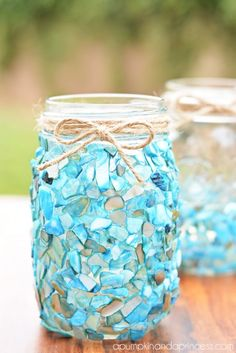 DIY Beach-Inspired Candle Lantern - use glass adhesive to stick sea glass on mason jars. #Glass # Craft and #Ideas