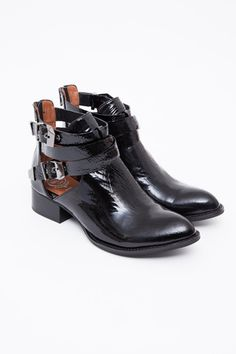 Just got these boots recently and they're SOOO cool to wear. Dress them up or down. No matter what, these beauties bring many compliments. Just be prepared! ;) Jeffrey Campbell - Exclusive Patent Crinkle Everly Boot