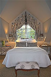 Very inviting space. The window treatment turned this attic bedroom into a elegant retreat.