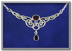 """Celtic Passion Necklace - Drawing on garnet's traditional association with love and devotion, this magnificent necklace boasts a duo of glittering garnets set amidst the ribbons of sterling silver knotwork. Simply stunning. Necklace is 18"""" long, and is adjustable to 17"""" or 16"""". Centerpiece is 2 5/8"""" wide."""