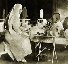 Queen Marie visiting a military hospital, 1917.