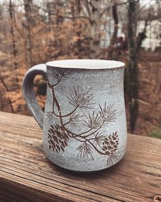 The first pine branch cups are out of the oven! S # sgraffito # toomanymugs # pinetree # pinecone # winterart # coffeeshop… Sgraffito, Slab Pottery, Pottery Mugs, Ceramic Pottery, Thrown Pottery, Ceramic Cups, Ceramic Art, Clay Mugs, Pine Branch