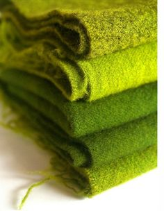 Wool blankets in shades of green