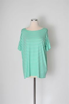 How cute is our Peter Pipers Top? A short sleeved top with stripes. Wear with your favorite pair of jeans to be ready for the day! Also available in navy, coral, and ivory.