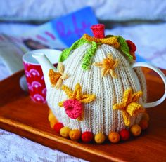 "Free knitting pattern available for Daffodil Tea Cosy from ""Tea Cosies"" available from this website."