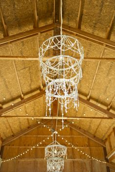 Gorgeous crystal #chandeliers hang from the #barn at this #ranch wedding {Hearts & Horseshoes Photography}